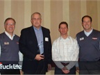 (L-R) Dick Giromini, President & CEO, Wabash National Corporation; Brian Kupchella, President & COO, Truck-Lite Co. LLC; Jon Stineman, National Sales Director, Truck-Lite Co. LLC; Mark Webber, CFO, Wabash National Corporation.
