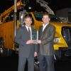Work Truck Associate Publisher Bob Brown (r) presents the Medium-Duty Truck of the Year award to Len DeLuca, director of Ford Commercial Trucks.