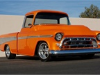 This 1957 Chevrolet Cameo Pickup, finished in full custom Orange Pearl
