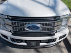 A satin chrome grille includes chrome C-clamps.