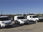 Three white 2015 ProMaster City cargo vans are ready to take on an obstacle course.