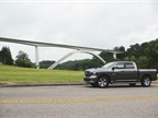 In the background, the Natchez Trace Parkway Bridge is the nation's first segmentally constructed concrete arch bridge. Spanning 1,648 feet, the double arch structure offers motorists a view from 155 feet above the valley floor. Source: Lauren Fletcher