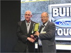Work Truck Editor Mike Antich presents John Ruppert, General Manager